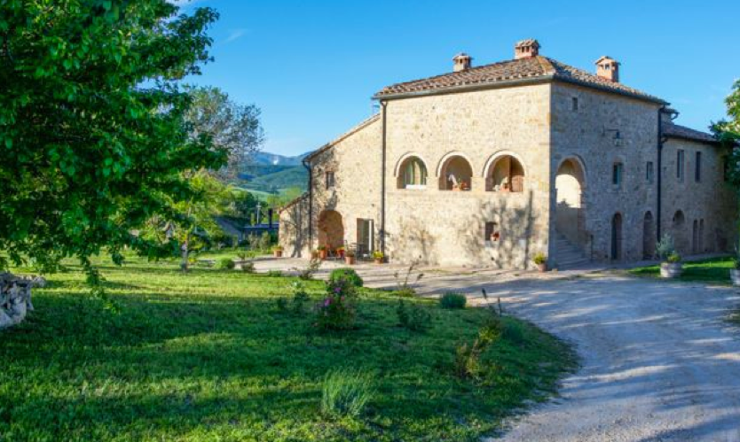 A Tuscan apartment for sale overlooking the countryside.