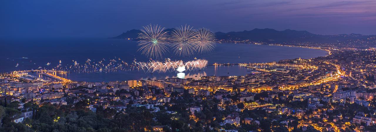 Cannes, overlooking the harbour at night with fireworks near Prestige Property