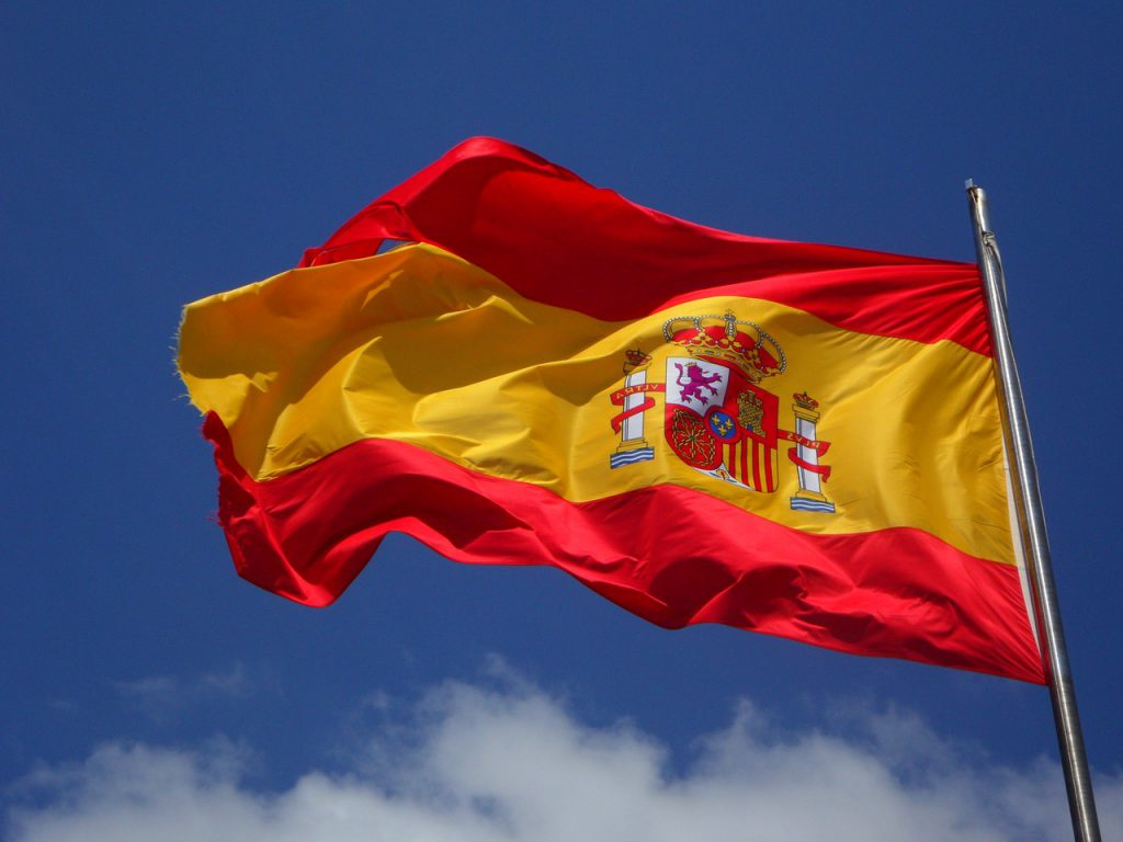 Spanish flag flies outside Spanish property for sale.